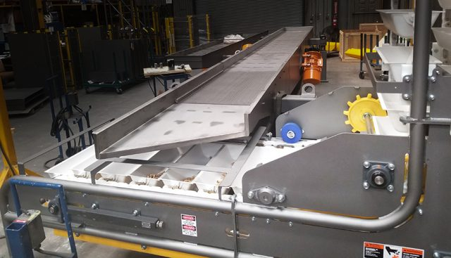Using a sanitary conveyor design integrated into a bulk material handling system protects your product.